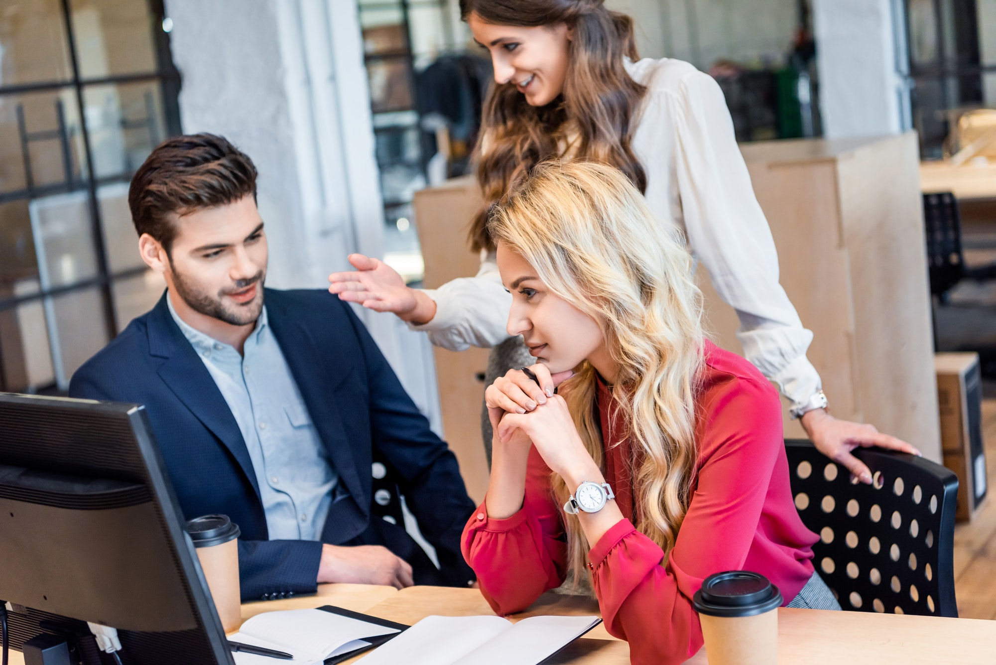 businessman and businesswomen working on business idea together in office